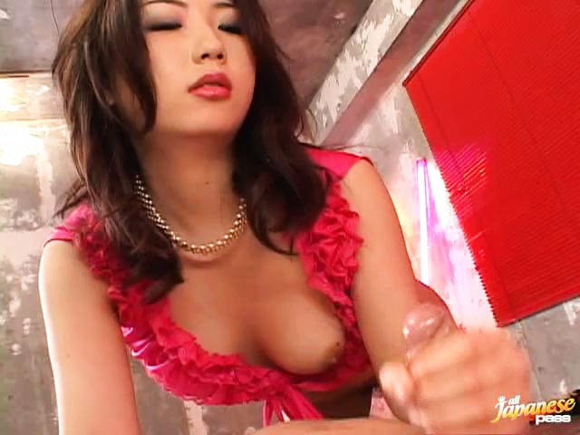 Hatsumi Kudo in pink ruffles gobbling a hard cock