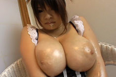 Ayumi Ayukawa Hot Asian model shows her tits in the kitchen