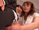 Hot Japanese girl is giving handjob on the subway