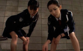 Asian female prison guard does hard duty