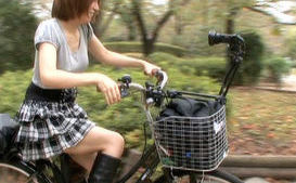 Yuki Mizuho Asian doll rides on a crazy bike