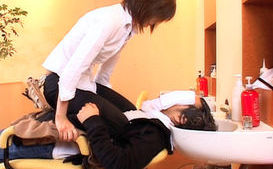 Asian model is a hairdresser in a sexy salon for men