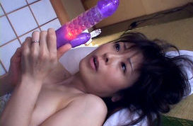 Hitomi Kurosaki Lovely Asian gal is a mature sexy model