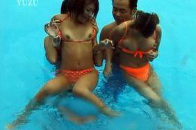 Hot girls Mai Sakurai and Rara Motofuji in bikini playing at the pool
