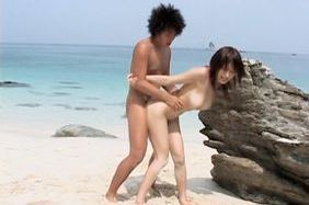 Busty Japanese teen gets a tit squeeze and a big cock inside her at the beach