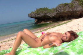 Kokomi Naruse Lovely Japanese model shows her tits at the beach