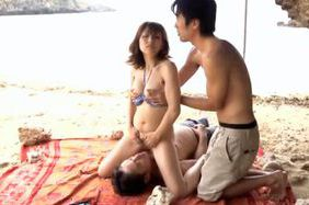 Asian babe Yuuko Shiraki enjoys having sex on the beach