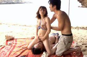 Asian babe Yuuko Shiraki enjoys having sex on the beach