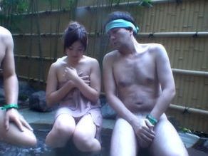 Pretty Japanese girl gets molested in the hot springs